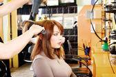 Hairdresser makes a hair dress — Stock Photo