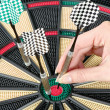 Taking out dart from dartboard — Stock Photo