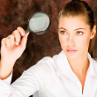 Researcher looking through magnifier glass — Stock Photo