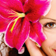 Big flower in woman's hair — Stock Photo #29274559