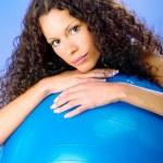 Curls hair women on blue pilates ball — Stock Photo #29274939