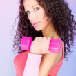 Curls hair girl holding weight for exercise — Stock Photo