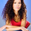 Pretty curls hair women on blue pilates ball — Stock Photo