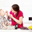 Mother feeding child with grapes — Stock Photo #29907137
