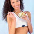 Fitness girl holding plate with salad — Stock Photo