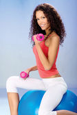 Weight exercise on the big blue ball — Stock Photo