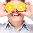 Chubby boy and orange — Stock Photo