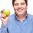 Chubby mholding apple — Stock Photo #34088421