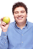 Chubby man holding apple — Stock Photo