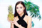 Woman holding pineapple — Stock Photo