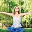 Stock Photo: Woman at meditation outdoor