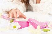 Woman taking cream — Stock Photo