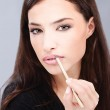 Woman applying cosmetic pencil on her lips — Stock Photo #7796896