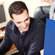 Manager with his employer in office checking document — Stock Photo #8275485