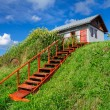 Stock Photo: Village house at hill, with stairs