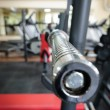 Empty barbell bar waiting to workout — Stock Photo