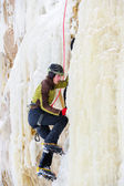 Young man climbing the ice — Stock Photo