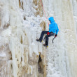 Stock Photo: Young mclimbing ice