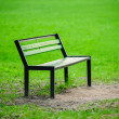 Lonely broken bench in the park — Stock Photo #39436095