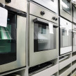 Home appliance  store, row of ovens — Stock Photo #41182277