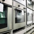 Home appliance store, row of ovens — Stock Photo