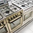 Stock Photo: Home appliance  store, row of gas stoves