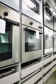 Home appliance  store, row of ovens — Foto Stock