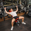 Stock Photo: Young mdoing Barbell Incline Bench Press workout in gym