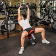 Stock Photo: Young mdoing Dumbbell Incline Bench Press workout in gym