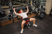 Young man doing Barbell Incline Bench Press workout in gym — Stock Photo