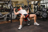 Young man doing Dumbbell Incline Bench Press workout in gym — Stock Photo
