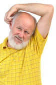 Balding senior man skratching his other ear — Stock Photo
