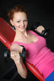 Young girl doing Dumbbell Incline Bench Press workout  — Stock Photo