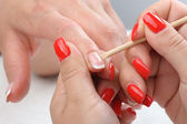 Manicure applying - cleaning the cuticles — Stock Photo