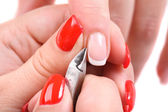 Manicure applying - cutting the cuticle — Stock Photo