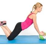 Female pushups on medicine ball — Stock Photo #8616552