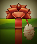 Gift box with red ribbon bow and label — Stockvector