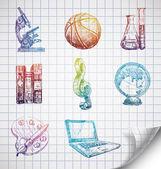 Icone scuola disegnati a mano su carta foderata sketchbook. — Vettoriale Stock
