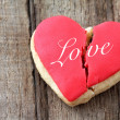 Stock Photo: Cracked heart shaped cookie