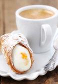 Cannoli with coffee — Stock Photo