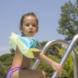 Little girl by the swimming pool — Stock Photo