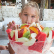Girl eating fruit salad — Stock Photo