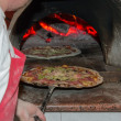 Chef put pizzin oven — Stock Photo #13176498