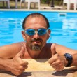 Man in the swimming pool — Stock Photo
