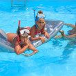 Mother and children in the swimming pool — Stock Photo