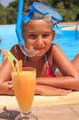 Girl with juice in the swimming pool — Stock Photo