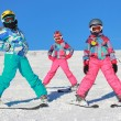 Stock Photo: Three girls with ski on snow
