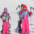 Three girls with ski on the snow — Stock Photo