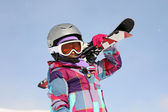 Girl with ski on the shoulder — Stock Photo