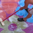 Stock Photo: Man washing carpet